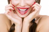 Beautiful Smiling Girl With Retainer For Teeth Sticking Her Tongue Out, Close-up