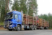 Blue Sisu Polar Timber Truck Hauls Timber