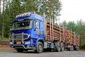 Blue Sisu Polar Timber Truck Hauls Spruce Logs