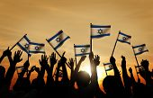pic of waving  - Silhouettes of People Waving the Flag of Israel - JPG