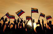 Group of People Waving Venezuelan Flags in Back Lit