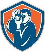 Photographer Aiming Camera Shield Retro