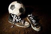 Soccer ball on ground on dark background