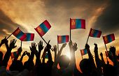 stock photo of mongolian  - Group of People Waving Mongolian Flags in Back Lit - JPG