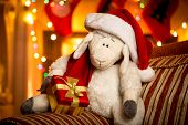 Toy Sheep With Gift Box At Decorated For Christmas Living Room