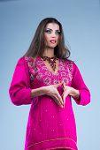 Pretty European woman posing in Indian Style