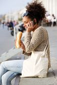 African American Woman Talking On Mobile Phone Outdoors