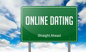 Online Dating on Highway Signpost.