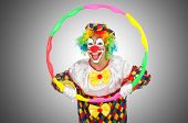 Clown with hula hoop isolated on white