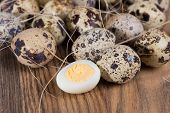 Quail Eggs Lie In A Nest On The Boards