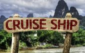 Cruise Ship sign with a forest background