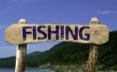 Fishing sign with a beach on background