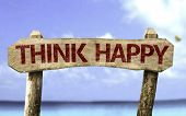 Think Happy sign with a beach on background