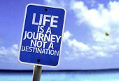 Life is a Journey not a Destination sign with a beach on background poster