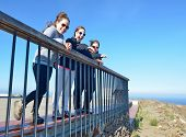 Mother And Daughters Enjoying The Costa Brava Winds And Views