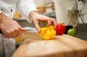 man's hands cutting pepper. Salad preparation