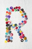 Letter R Of The Alphabet Of Buttons Of Various Shapes And Colors