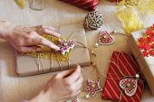 Woman Hands Wrapping Christmas Gift Box