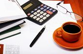 Calculator,pen, Notebook And Business Reports. Coffee Break
