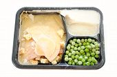 stock photo of frozen  - A Frozen Turkey TV Dinner Over White - JPG