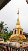 Praying Angel Statue Beside The Buddhist Pagoda
