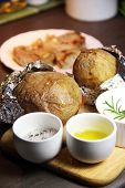 Baked Potato On The Wooden Tray And Mix Of Spices