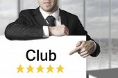 Businessman Pointing On Sign Club