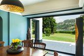 Interior, modern house, dining room, veranda view
