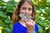 Girl holding finger Rice Paper butterfly Idea leuconoe in outdoor