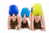 twin kid sisters girls friends playing as flexible contortionist happy on white background