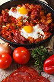 Fried Eggs With Chorizo  And The Ingredients On The Table.