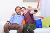 Two Friends Doing Selfie On The Sofa