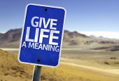Give Life a Meaning sign with a desert background