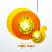 Beautiful shiny golden hanging X-mas balls for Merry Christmas celebration on abstract background.