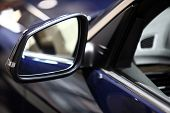 picture of mirror  - Color vertical shot of a blue car - JPG