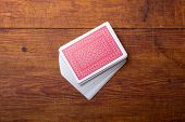 stock photo of ace spades  - deck of cards on wooden table - JPG