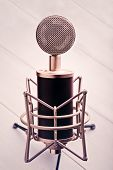 picture of condensation  - Large diaphragm condenser microphone on a wooden table - JPG