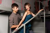 foto of office romance  - Young couple flirting in office - JPG