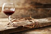 picture of crown-of-thorns  - Crown of thorns and glass of wine on old wooden background - JPG