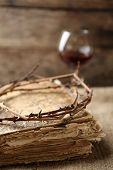 foto of crown  - Crown of thorns and bible on old wooden background - JPG