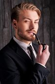 image of toothless smile  - Portrait of handsome young man in formalwear smoking a pipe and smiling at camera - JPG