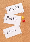 Hope, Faith And Love Cards On Corkboard