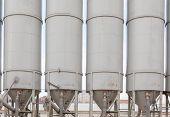 pic of silo  - Group of production silos on the cement factory close up - JPG