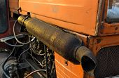 stock photo of exhaust pipes  - Rusty exhaust pipe of a tractor old - JPG