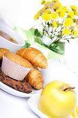 foto of continental food  - continental breakfast with croissants cake chocolate cookies apple and tea - JPG