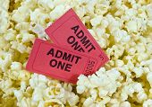 stock photo of popcorn  - Close up shot of red movie tickets in popcorn - JPG