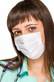 image of female mask  - Female doctor wearing surgical mask isolated on white - JPG