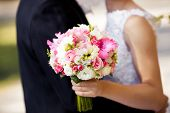 pic of gladiolus  - Colorful wedding bouquet with roses and gladiolus on the grass - JPG