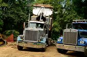 foto of dump  - A dump truck unloading gravel for a river side walking path in a small park city park in Oregon - JPG