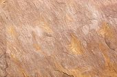image of slab  - Detail of the abstract pattern of an ocher stone slab with a slight relief - JPG